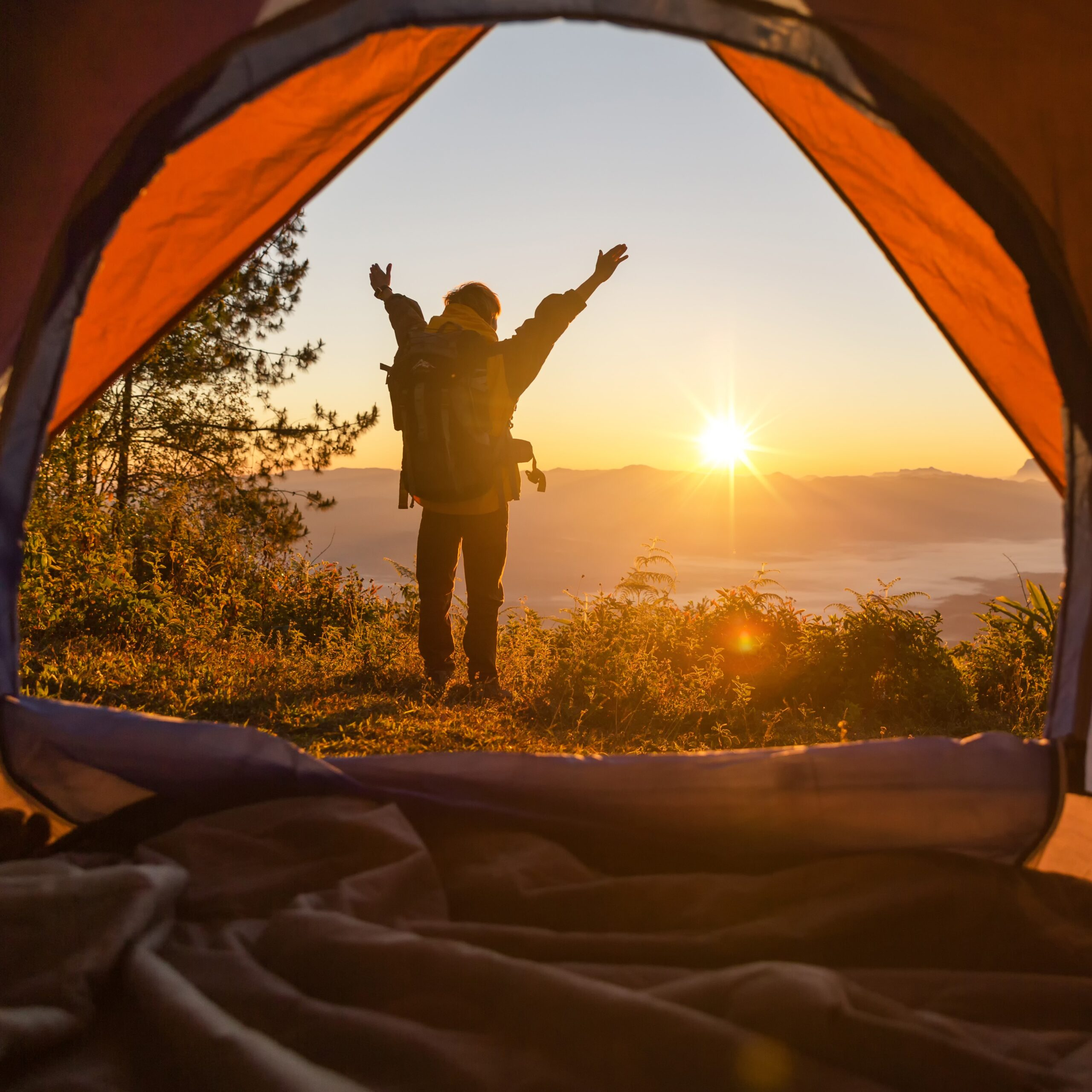 hiker-stand-camping-front-orange-scaled.jpg
