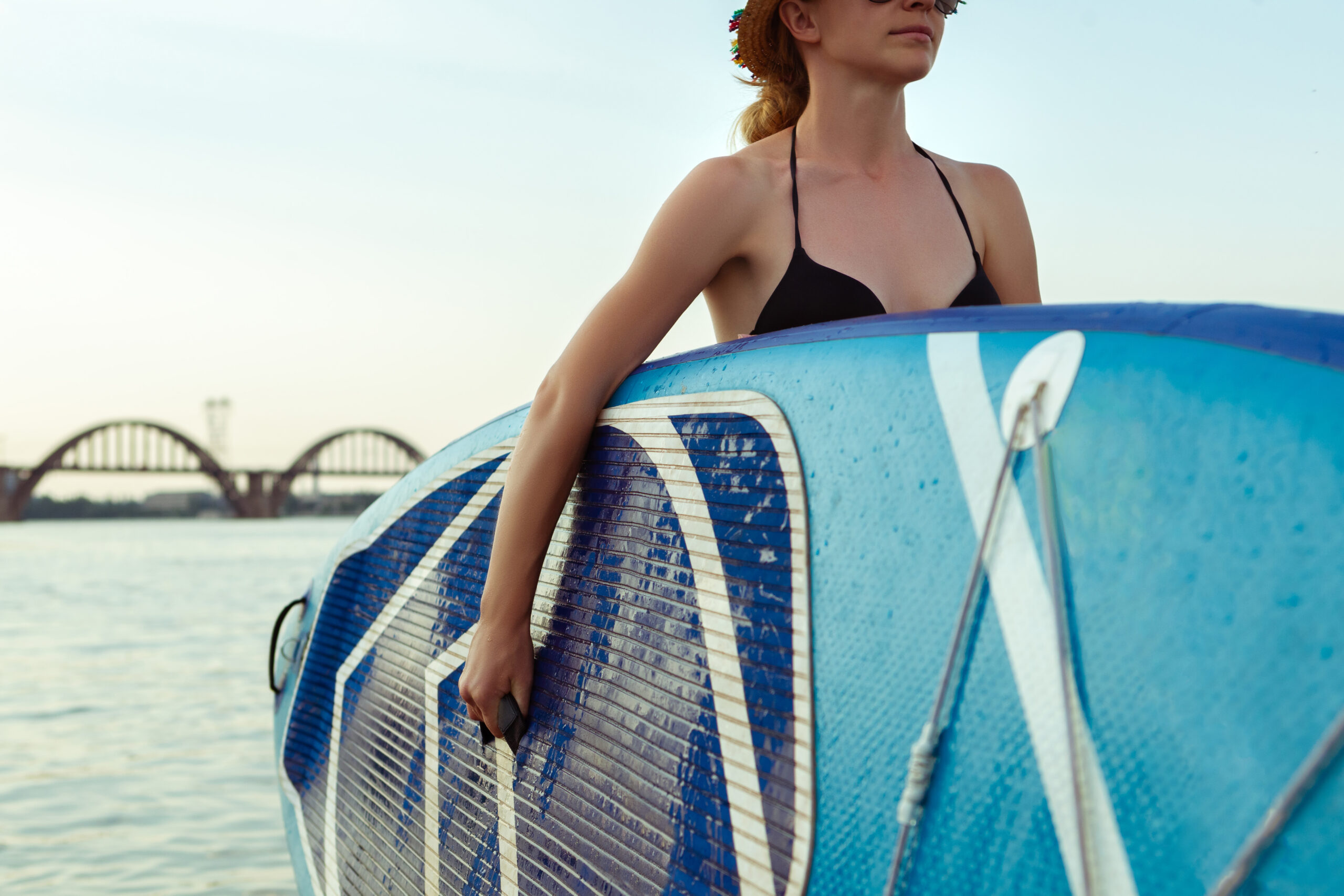 young-attractive-woman-sitting-on-paddle-board-1-scaled.jpg
