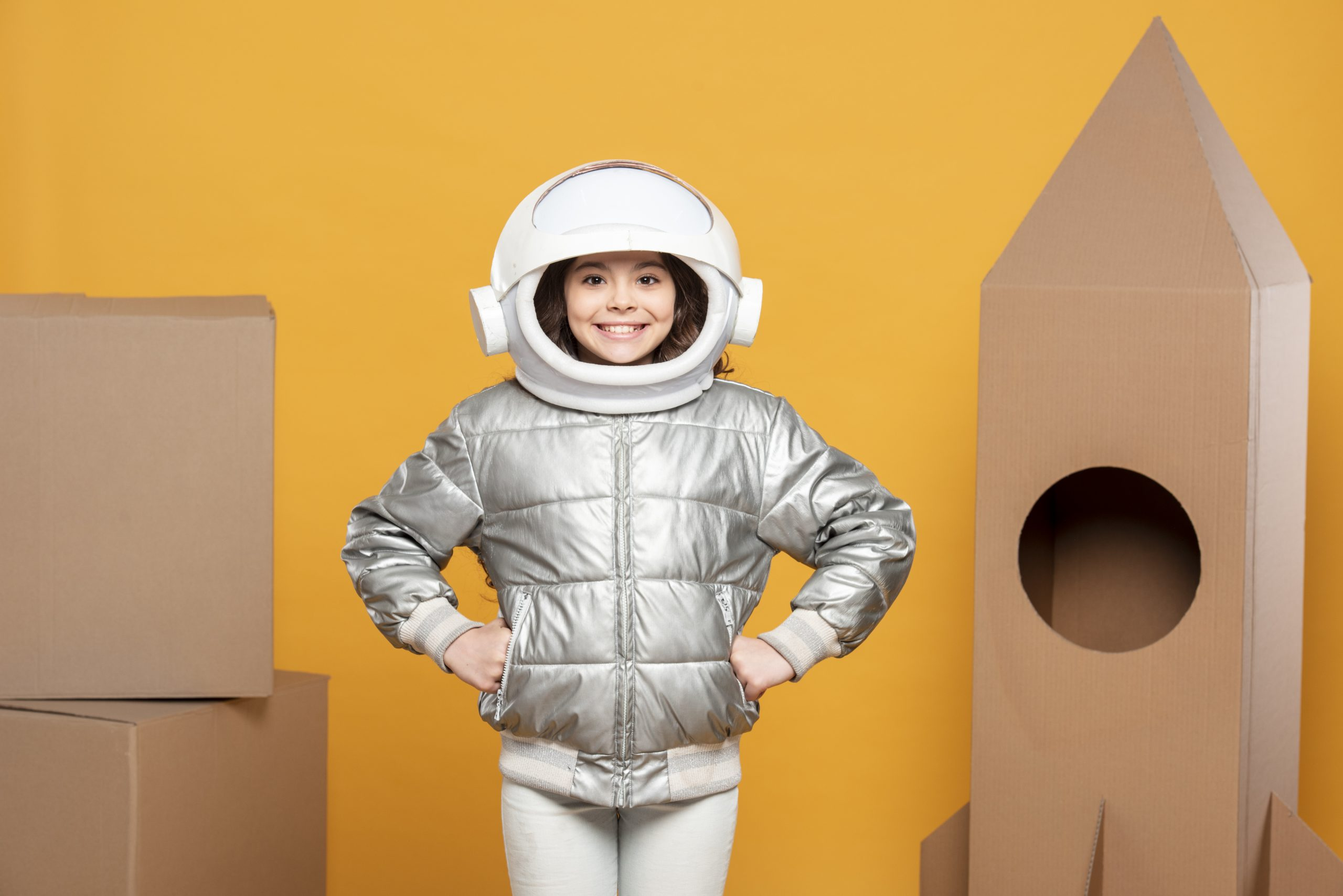 girl-with-space-helmet-ship-made-carton-scaled.jpg